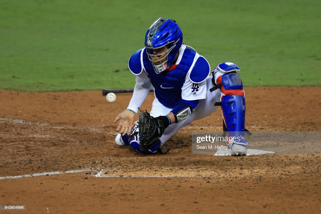 Yasmani Grandal #9 of the Los Angeles Dodgers receives a throw to home during a game against the Arizona Diamondbacks at Dodger Stadium on September 5, 2017 in Los Angeles, California.