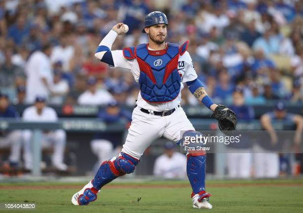 Yasmani Grandal of the Los Angeles Dodgers throws out the runner during the second inning against the Boston Red Sox in Game Three of the 2018 World...