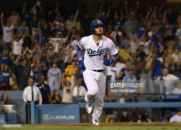 Yasmani Grandal of the Los Angeles Dodgers watches as the ball go for a tworun walkoff homerun over the right field fence in the tenth inning of the...