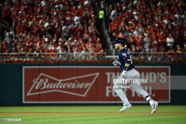 Yasmani Grandal of the Milwaukee Brewers celebrates after hitting a two run home run to score Trent Grisham against Max Scherzer of the Washington...