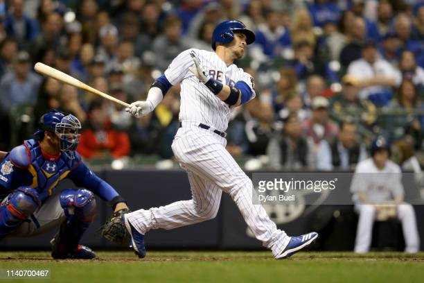 Yasmani Grandal of the Milwaukee Brewers hits a single in the fifth inning against the Chicago Cubs at Miller Park on April 05 2019 in Milwaukee...