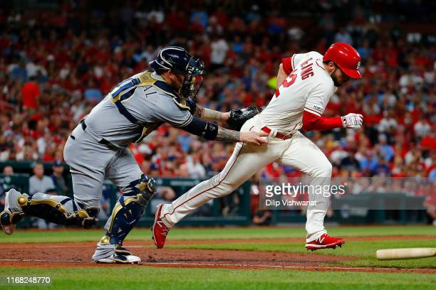 Yasmani Grandal of the Milwaukee Brewers tags out Paul DeJong of the St. Louis Cardinals in the sixth inning at Busch Stadium on September 14, 2019...