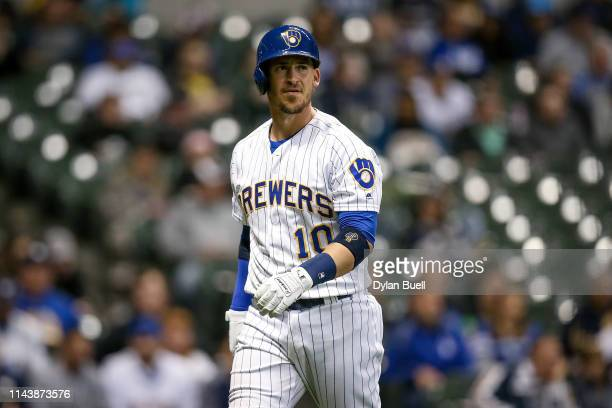 Yasmani Grandal of the Milwaukee Brewers walks back to the dugout after striking out in the eighth inning against the Los Angeles Dodgers at Miller...