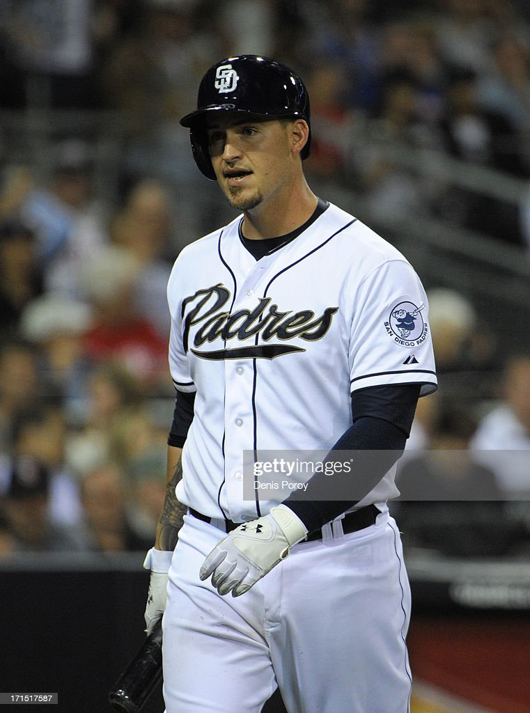 Yasmani Grandal #12 of the San Diego Padres walks back to the dugout after striking out during the seventh inning of a baseball game against the Philadelphia Phillies at Petco Park on June 25, 2013 in San Diego, California.