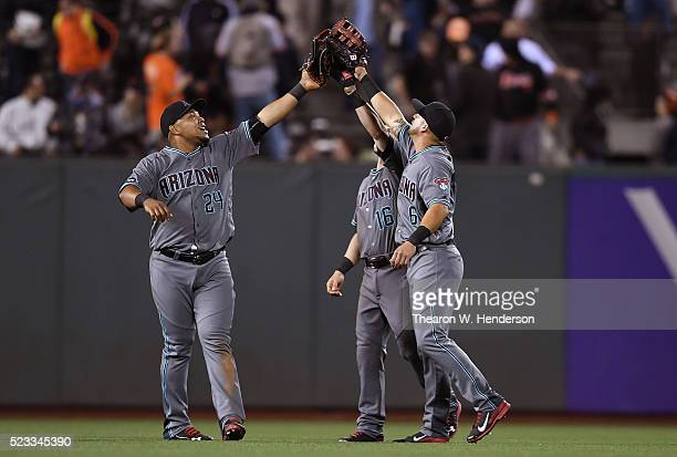Yasmany Tomas Chris Owings and David Peralta of the Arizona Diamondbacks celebrates defeating the San Francisco Giants 30 at ATT Park on April 19...