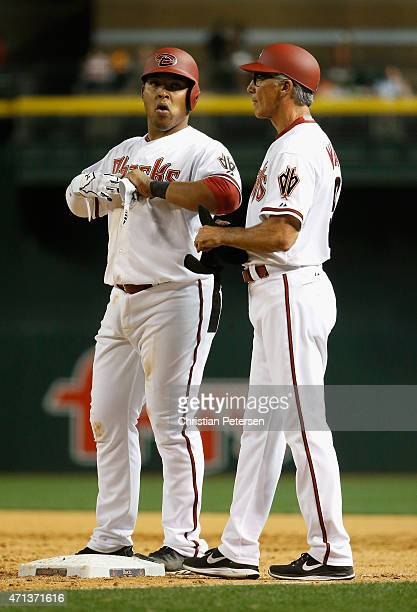 Yasmany Tomas of the Arizona Diamondbacks at first base with first base coach Dave McKay during the MLB game against the Texas Rangers at Chase Field...