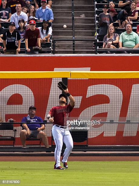 Yasmany Tomas of the Arizona Diamondbacks awaits a fly ball in the second inning of the MLB game against the San Diego Padres at Chase Field on...