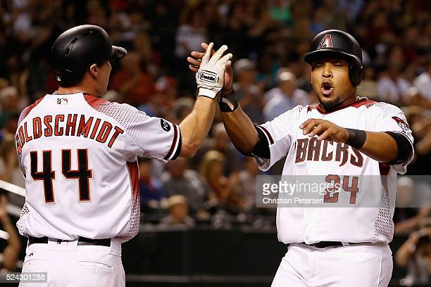 Yasmany Tomas of the Arizona Diamondbacks high-fives Paul Goldschmidt after scoring against the St. Louis Cardinals during the sixth inning of the...