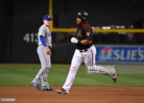 Yasmany Tomas of the Arizona Diamondbacks rounds the bases after hitting a firstinning home run off of pitcher Kenta Maeda of the Los Angeles Dodgers...