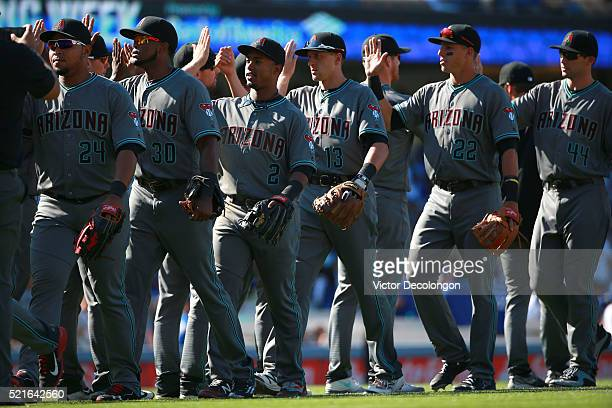 Yasmany Tomas Socrates Brito Jean Segura Nick Ahmed Jake Lamb Paul Goldschmidt and their Arizona Diamondbacks teammates celebrate with high fives...
