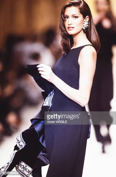 Yasmeen Ghauri walks the runway at the Valentino Ready to Wear Fall/Winter 1992-1993 fashion show during the Paris Fashion Week in March, 1992 in...
