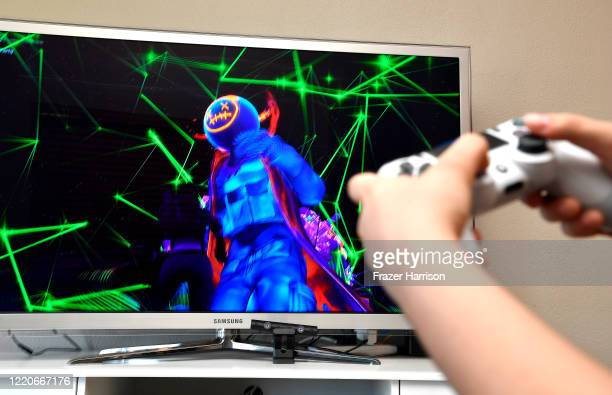 Yasmin 15 years old and the photographer's daughter plays Fortnite featuring Travis Scott Presents Astronomical on April 23 2020 in Los Angeles...