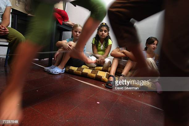 Yasmin an Arab schoolgirl and her Jewish friends play during recess at the Hand in Hand Center for JewishArab Education October 9 2007 in Jerusalem...