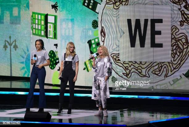 Yasmin Evans Becca Dudley and Laura Whitmore on stage at We Day UK at Wembley Arena on March 7 2018 in London England