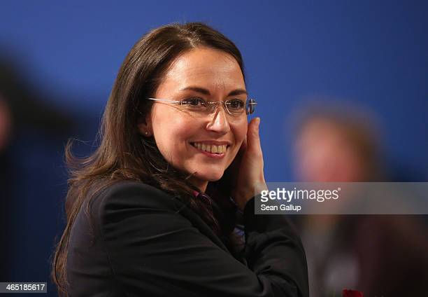 Yasmin Fahimi smiles after she received 885% of the vote of delegates to become the new General Secretary of the German Social Democrats during a...