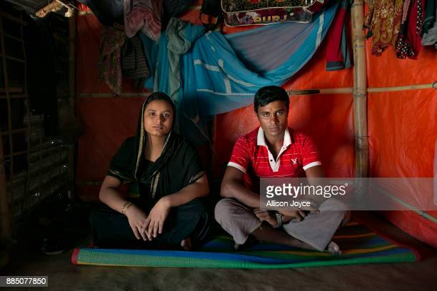 COX'S BAZAR BANGLADESH NOVEMBER 25 Yasmin from Qupin village in Myanmar and 21 year old Mohammad Tahir from Nashaque village in Myanmar pose for a...