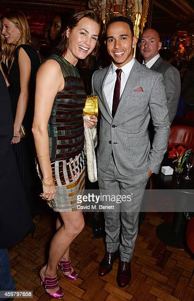 Yasmin Le Bon and Lewis Hamilton attend a party in celebration of Edward Enninful in The Oscar Wilde Bar Hotel Cafe Royal on December 1 2014 in...