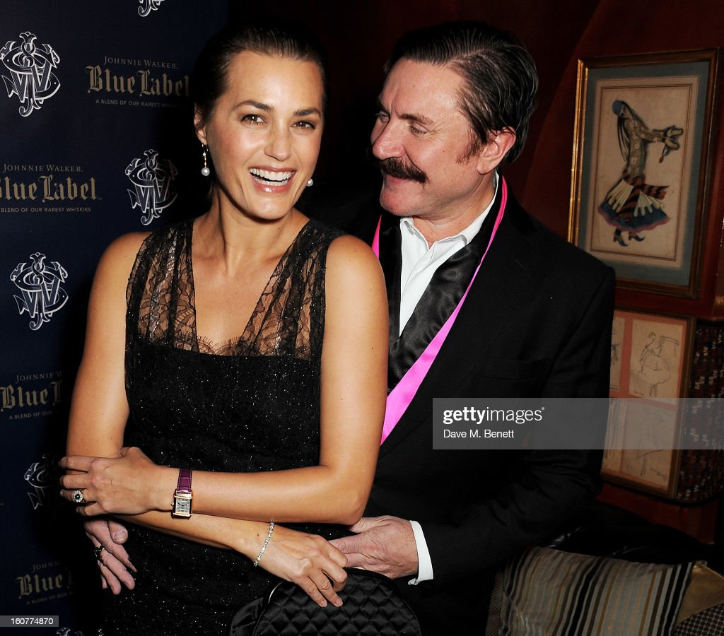 Yasmin Le Bon (L) and Simon Le Bon attend a party celebrating the new partnership between Johnnie Walker Blue Label and model David Gandy at Annabels on February 5, 2013 in London, England.
