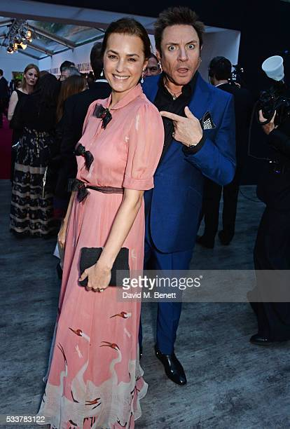 Yasmin Le Bon and Simon Le Bon attend British Vogue's Centenary gala dinner at Kensington Gardens on May 23 2016 in London England