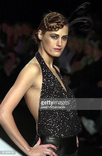 Yasmin Le Bon models a spangled halterneck designed by Ronit Zilkha 18 February 2001 on the first day of the London Fashion Week readytowear shows