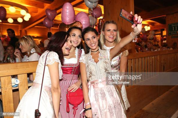 Yasmin Lord blogger influencer Rona Oezkan Nadine Menz and Vanessa Meisinger take a selfie at the 'Madlwiesn' event during the Oktoberfest at...