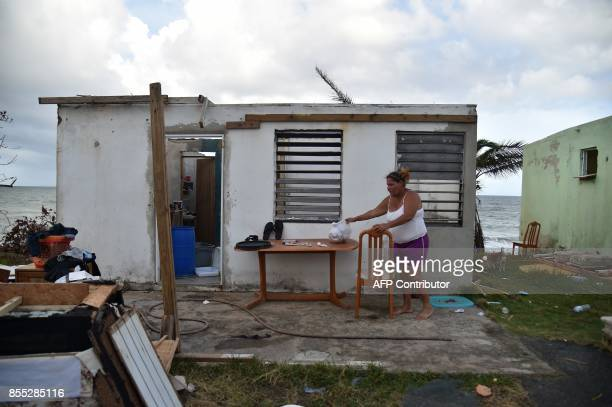 TOPSHOT Yasmin Morales is pictured on September 28 2017 in her damaged house in Yabucoa in the eastern part of stormbattered Puerto Rico following a...