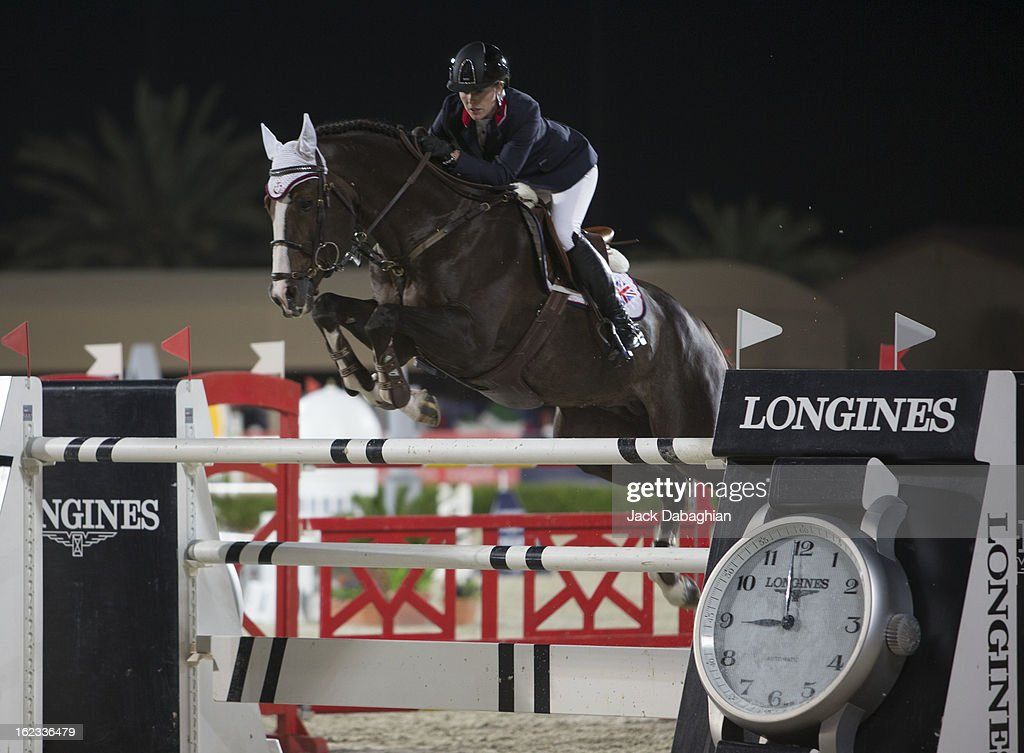 Yasmin Pinchen of Great Britain clears a hurdle on Van de Valdi during the President of the UAE Showjumping Cup - Furusyiah Nations Cup Series presented by Longines on February 21, 2013 in Al Ain, United Arab Emirates.
