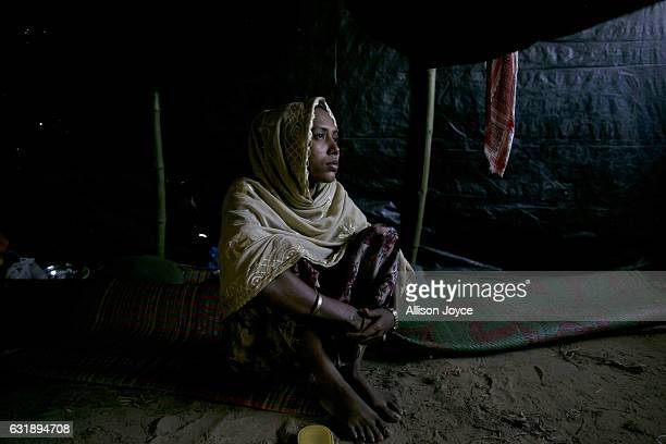 Yasmin poses for a photo on the floor of her home in Balu Kali refugee camp is seen on January 17 2017 in Cox's Bazar Bangladesh 1 week ago she...