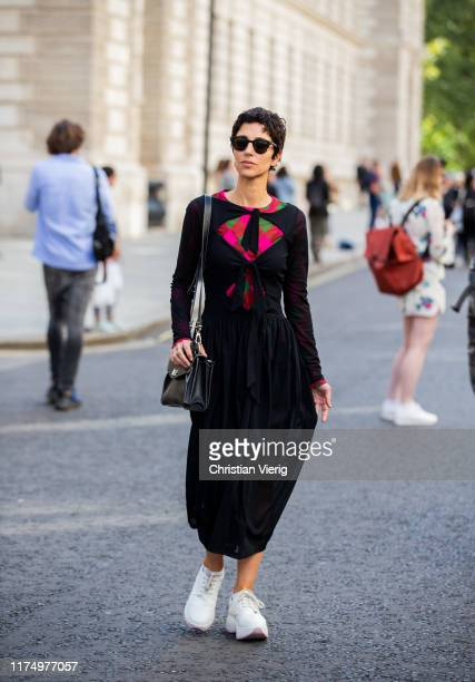 Yasmin Sewell is seen wearing black sheer dress outside Victoria Beckham during London Fashion Week September 2019 on September 15, 2019 in London,...