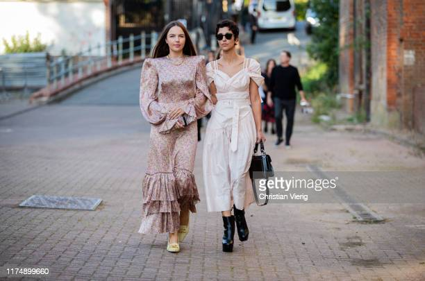 Yasmin Sewell is seen wearing creme white dress, black bag and boots outside Rocha during London Fashion Week September 2019 on September 15, 2019 in...