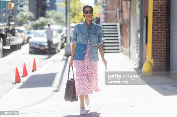Yasmin Sewell wearing a dress and denim jacket seen in the streets of Manhattan outside Self-Portrait during New York Fashion Week on September 9,...