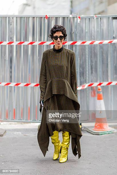 Yasmin Sewell wearing a dress and golden boots outside during London Fashion Week Spring/Summer collections 2017 on September 19 2016 in London...