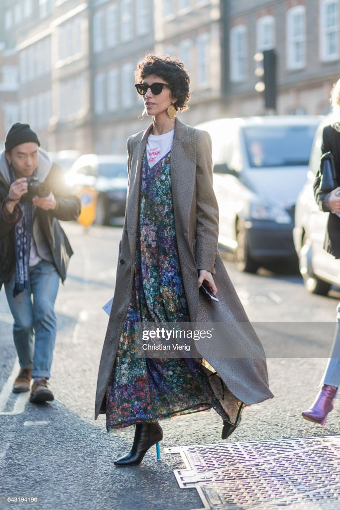 Yasmin Sewell wearing a dress with floral print, grey coat outside J.W. Anderson on day 2 of the London Fashion Week February 2017 collections on February 18, 2017 in London, England.