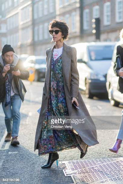 Yasmin Sewell wearing a dress with floral print grey coat outside JW Anderson on day 2 of the London Fashion Week February 2017 collections on...