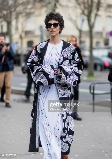 Yasmin Sewell wearing a white dress kimono outside Ellery on March 7 2017 in Paris France