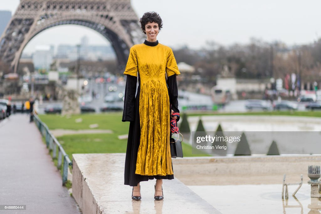 Yasmin Sewell wearing a yellow mustard coloured dress outside Hermes on March 6, 2017 in Paris, France.