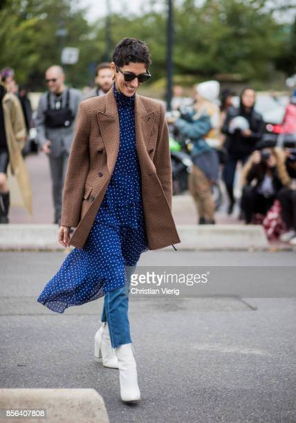 Yasmin Sewell wearing brown checked jacket dress with dots prints denim jeans white boots seen outside Balenciaga during Paris Fashion Week...