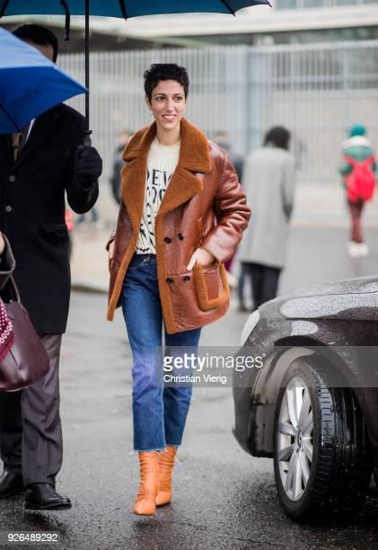 Yasmin Sewell wearing shearling jacket outside Loewe on March 2 2018 in Paris France