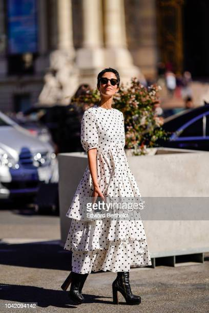 Yasmin Sewell wears a white ruffle dress with black polka dots outside Paco Rabanne during Paris Fashion Week Womenswear Spring/Summer 2019 on...