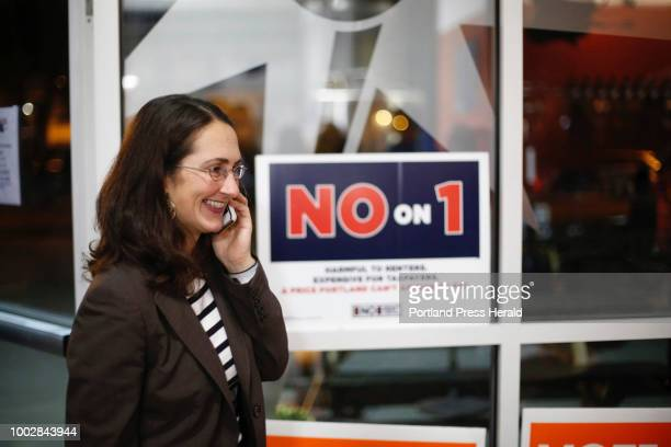 Yasmin Vitalius wife of Brit Vitalius spokesman for Say No To Rent Control No on 1 talks on the phone at an election results gathering at Rising Tide...