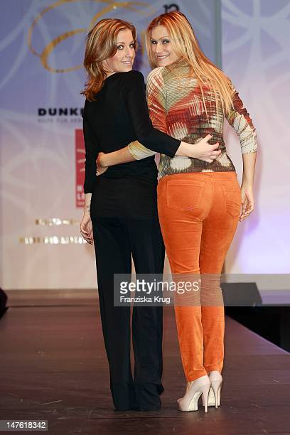Yasmina Filali and Charlotte Engelhardt show designs on the catwalk during the charity event 'Event Prominent' at the Hotel Grand Elysee on March 25...