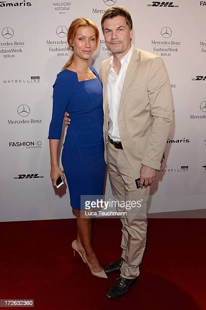 Yasmina Filali and Thomas Helmer attend the Laurel Show during the MercedesBenz Fashion Week Spring/Summer 2014 at Brandenburg Gate on July 4 2013 in...