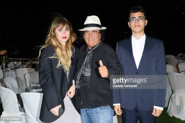 Yasmine Carrisi Al Bano Carrisi and Albano Carrisi Jr attend 2019 Ischia Global Film Music Fest on July 15 2019 in Ischia Italy