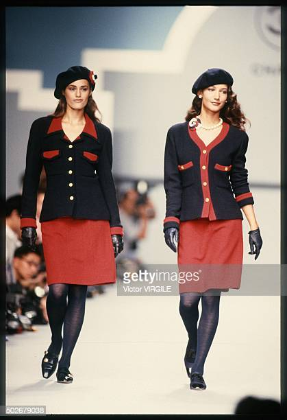 Yasmine Le Bon and Marpessa Hennink walk the runway during the Chanel Ready to Wear show as part of Paris Fashion Week Spring/Summer 19891990 in...