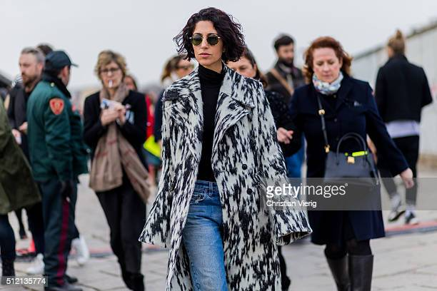 Yasmine Sewell wearing a black white wool coat seen outside Gucci during Milan Fashion Week Fall/Winter 2016/17 on February 24 2016 in Milan Italy