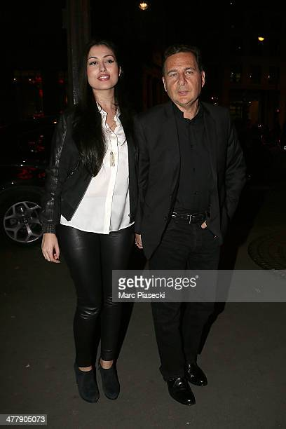 Yasmine Tordjman and Eric Besson arrive to attend the concert of Carla Bruni at Olympia hall on March 11 2014 in Paris France