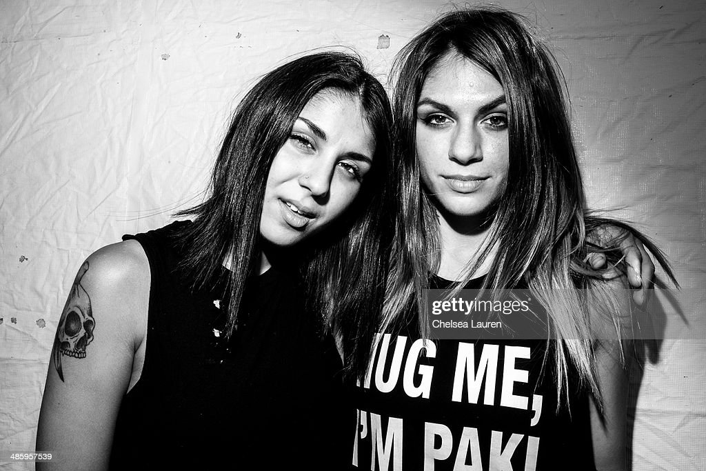 Yasmine Yousaf (L) and Jahan Yousaf of Krewella pose backstage at the Coachella valley music and arts festival at The Empire Polo Club on April 20, 2014 in Indio, California.