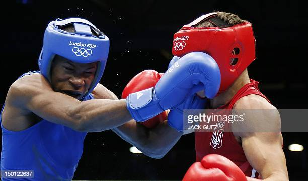 Yasnier Toledo Lopez of Cuba defends against Vasyl Lomachenko of the Ukraine during the men's Lightweight boxing semifinals of the 2012 London...