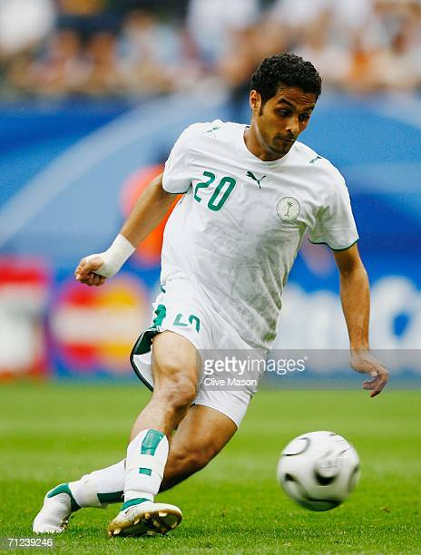 Yasser Al Kahtani of Saudi Arabia moves upfield with the ball during the FIFA World Cup Germany 2006 Group H match between Saudi Arabia and Ukraine...