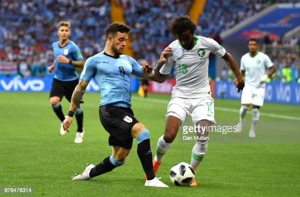 Yasser Alshahrani of Saudi Arabia is tackled by Nahitan Nandez of Uruguay during the 2018 FIFA World Cup Russia group A match between Uruguay and...